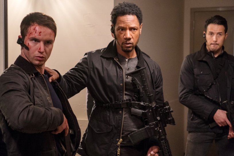 "COLONY -- ""Bonzo"" Episode 312 -- Pictured: (l-r) Will Brittain as Dave O'Neill, Tory Kittles as Broussard -- (Photo by: Daniel Power/USA Network)"